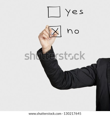 Beautiful woman writing her vote on glass board with a marker - stock photo