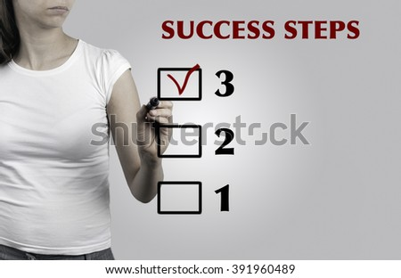Beautiful woman writing Success Steps, business concept