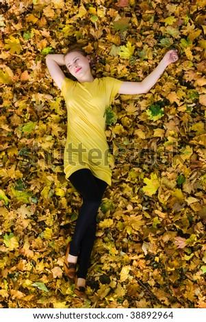 beautiful woman - yellow autumn leaves - fall - stock photo
