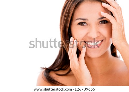 Beautiful womans face - isolated over a white background