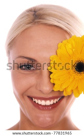 Beautiful womans face with yellow flower