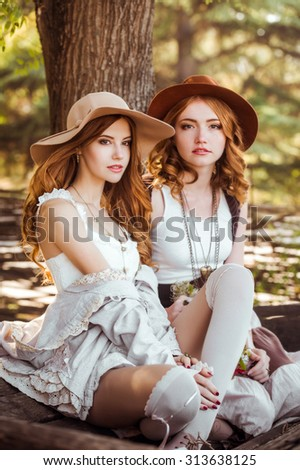 Beautiful women clothing style boho in autumn outdoor. Women in hats - stock photo