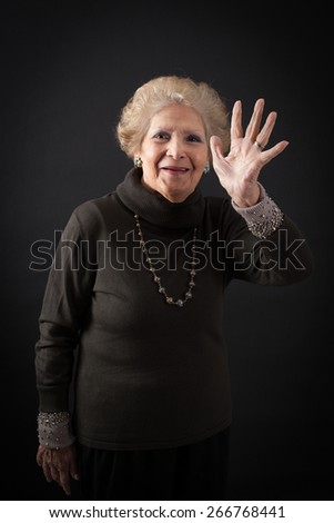 Beautiful women doing different expressions in different sets of clothes: waving - stock photo