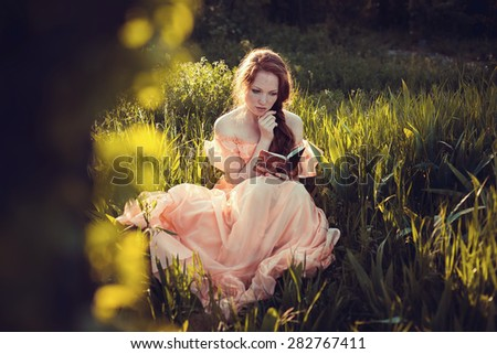 Beautiful women enjoying lilac garden, young women with flowers in green park. cheerful teenagers walking outdoor. soft light style color  - stock photo