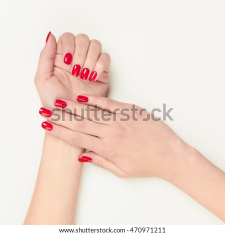Beautiful women hands perfect red nails