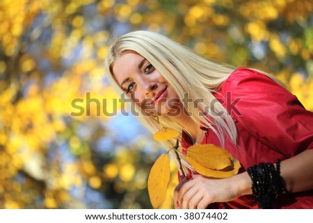 beautiful women in autumn park