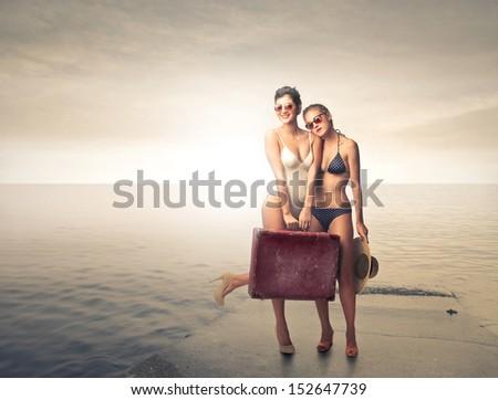 beautiful women in bikini at the sea - stock photo