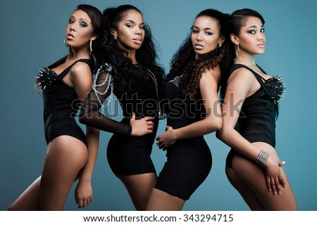 beautiful women in black clothes - stock photo