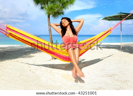 Beautiful women in the hammock on the beach - stock photo