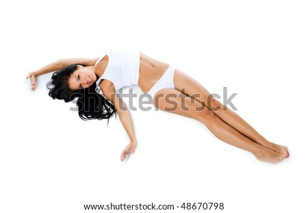 Beautiful women lie. Isolaed on a white background - stock photo
