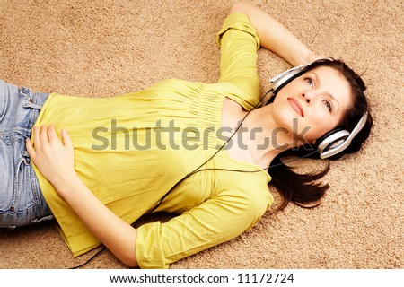 Beautiful women listening music in headphones - stock photo