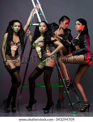 beautiful women near the ladder - stock photo