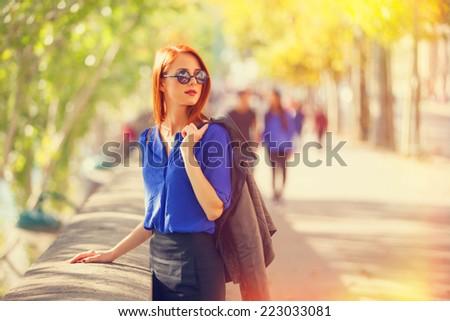Beautiful women on parisian streets - stock photo