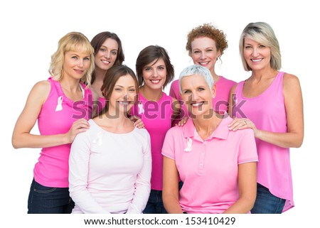 Beautiful women posing and wearing pink for breast cancer on white background - stock photo