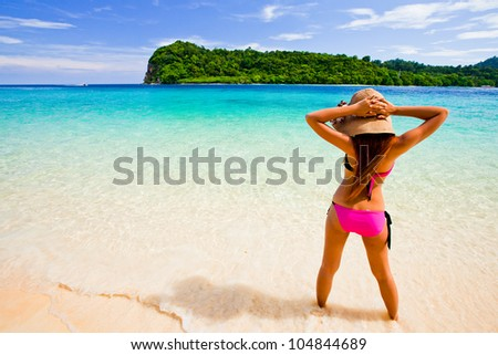 Beautiful women relax on the beach.