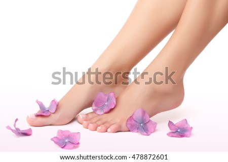 Beautiful women's legs with little purple flowers isolated on white background, body part, healthy treatment and beauty spa salon, no more pain concept