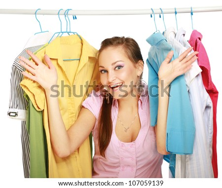 Beautiful women shopping for some clothes at a store isolated on white background - stock photo