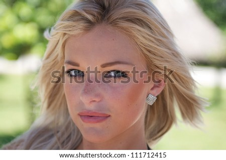Beautiful Women with blond hair and green eyes. - stock photo