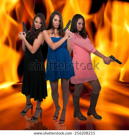 Beautiful women with loaded handgun pistols - stock photo
