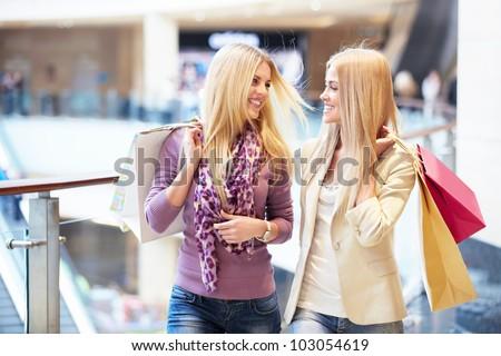 Beautiful women with shopping bags - stock photo