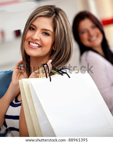 Beautiful women with shopping bags at a retail store