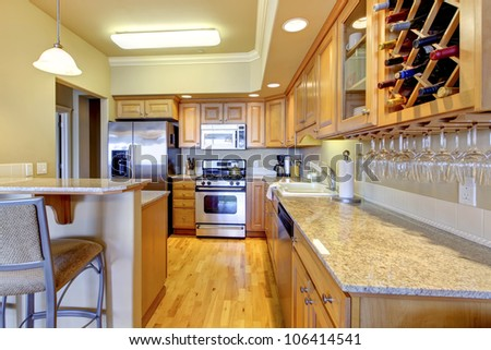 Beautiful wood golden kitchen in golden colors. - stock photo