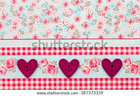 Beautiful wood sewing buttons scrap-booking heart shaped love red on a delicate floral background, background flowers for postcard, place for text. Figure heart wood handmade - stock photo