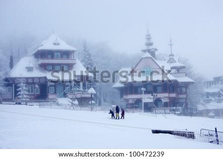 Beautiful wooden cabins in Czech republic, winter - stock photo