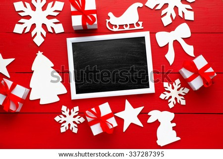 Beautiful wooden christmas background with wooden icons of snowflakes, Christmas trees, stars. New Year's holidays. Insert text. Christmas decorations. Wooden board rustic - stock photo