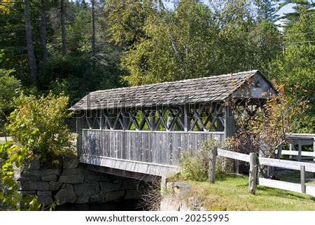 Beautiful wooden covered bridge in rural landscape