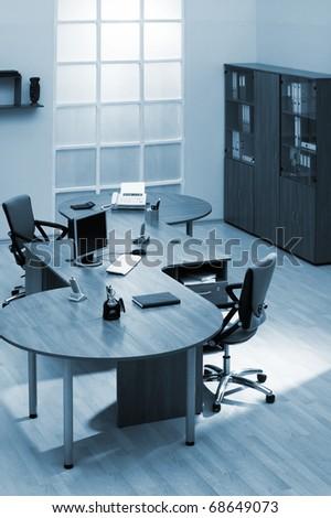 beautiful wooden desk in a modern office - stock photo