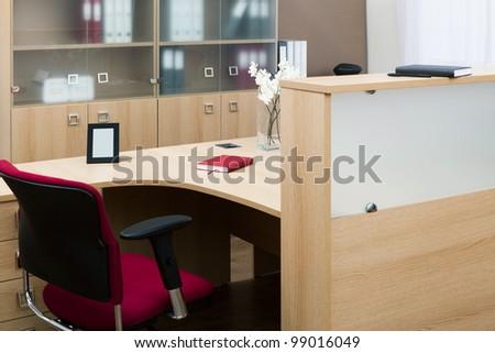 beautiful wooden desk in modern office - stock photo