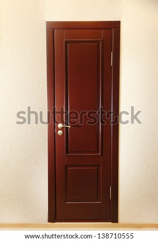 Beautiful wooden entrance door isolated on white - stock photo