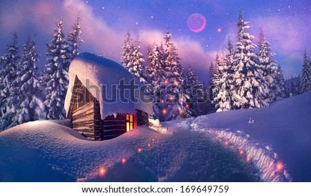 Beautiful wooden house as Santa Claus, with glowing window is located at the beginning of the lifting of the alpine heights. Climbers spend the night here and in morning go to the top to meet  new day - stock photo