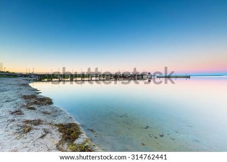 Beautiful wooden pier on Baltic sea shore. Wooden molo in Jastarnia on Hel peninsula. - stock photo