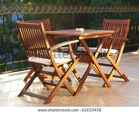 Beautiful, wooden summer bar on four persons - stock photo