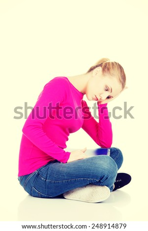 Beautiful worried woman is touching her temples.  - stock photo