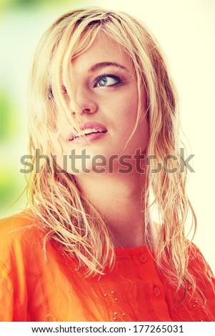 Beautiful woung  teen woman in orange shirt - stock photo