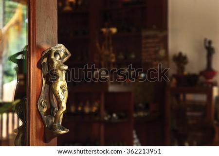 Beautiful wrought iron sculpture door handle. - stock photo