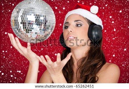beautiful xmas girl with headphones listening to music while snowing - stock photo
