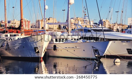 Beautiful Yachts at the Port of Barcelona Harbor, Spain at the sunset - stock photo
