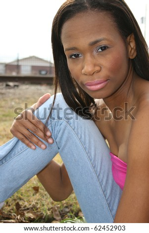 Beautiful 25 year old african american woman outside. - stock photo