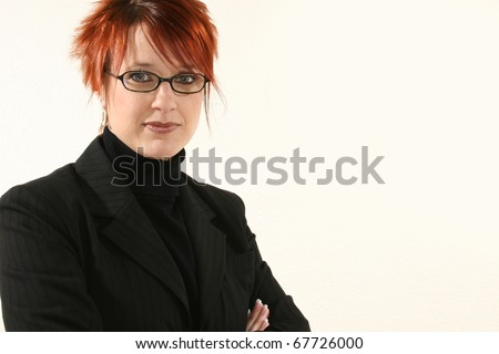 Beautiful 30 year old business woman in black suit with kind  expression.  With Glasses. - stock photo