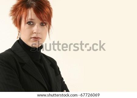 Beautiful 30 year old business woman in black suit with serious expression. - stock photo