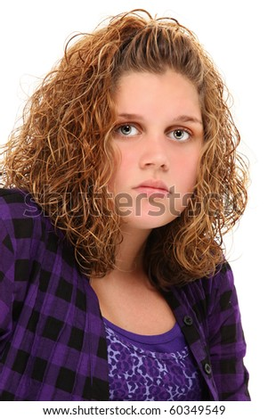 Beautiful 13 year old girl head-shot with serious expression over white background.