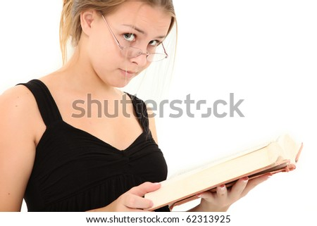 Beautiful 15 year old teenager with open book over white background. - stock photo