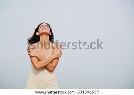 beautiful 35 years old woman standing on the shore of the beach - stock photo