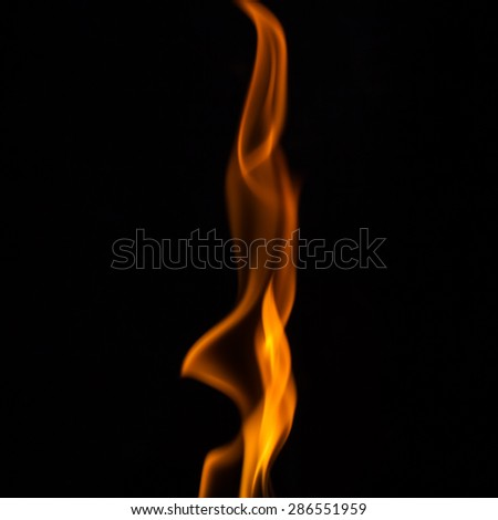 Beautiful yellow fire flames on black - stock photo