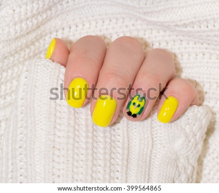 beautiful yellow nails with white cloth - stock photo