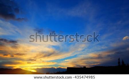 Beautiful yellow orange sunset blue sky. Sunrise. Nature background.  - stock photo